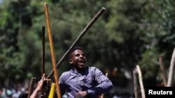 Des jeunes Oromo chantent des slogans lors d'une manifestation à Addis-Abeba, Ethiopie, le 24 octobre 2019. REUTERS/Tiksa Negeri