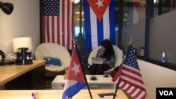 The office of Cuba Inspires is draped with U.S. and Cuban national flags. (J. Soh/VOA)