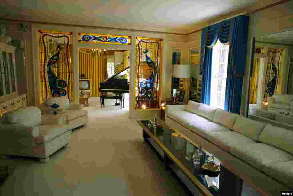 The front room and piano are shown during a tour of Graceland in Memphis, Tennessee, May 28, 2015. The estate that was home to Elvis Presley receives over 600,000 visitors a year and was declared a National Historic Monument in 2006.