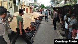 Keterangan foto: Situasi saat proses penangkapan terduga teroris di Kota Sibolga, Sumatera Utara hari Selasa (12/3). (Sumber: Istimewa)