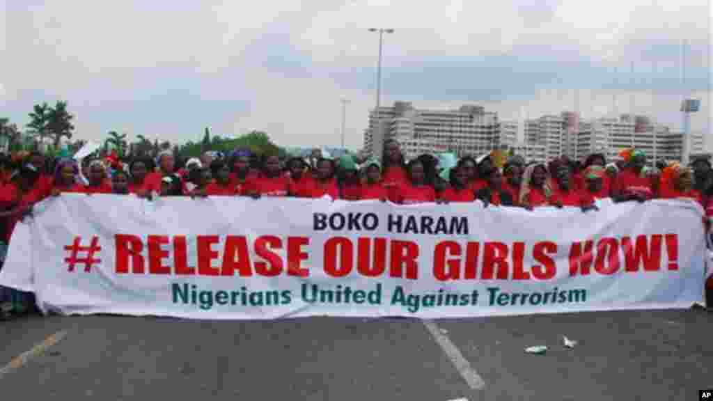 In this Monday, May 26, 2014, photo, the Nigerians United Against Terrorism group attends a demonstration calling on the government to rescue the kidnapped girls of the government secondary school in Chibok, in Abuja, Nigeria.