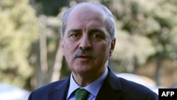 FILE - Turkish Deputy Prime Minister Numan Kurtulmus gives a statement after a security meeting at the Cankaya Palace in Ankara on January 12, 2016.