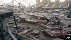 This photo provided by the anti-government activist group Aleppo Media Center, which has been authenticated based on its contents and AP reporting, shows a damaged school that was hit by a Syrian government air strike in Aleppo, Syria, April 30, 2014.