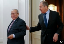 Russian Foreign Minister Sergey Lavrov, right, welcomes Algeria's Deputy Prime Minister Ramtane Lamamra for talks in Moscow, Russia, March 19, 2019.