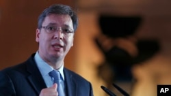FILE - Serbian Prime Minister Aleksandar Vucic speaks during the Business Forum Serbia-Albania, in the town of Nis, Serbia, Oct. 14, 2016.
