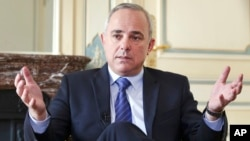 FILE - Israeli Strategic Affairs Minister Yuval Steinitz, shown in an interview in March 2015, says Iran continues to be a threat to his country and to all other nations in the Middle East.