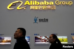 FILE - A sign of Alibaba Group is seen during the fourth World Internet Conference in Wuzhen, Zhejiang province, China, Dec. 3, 2017.