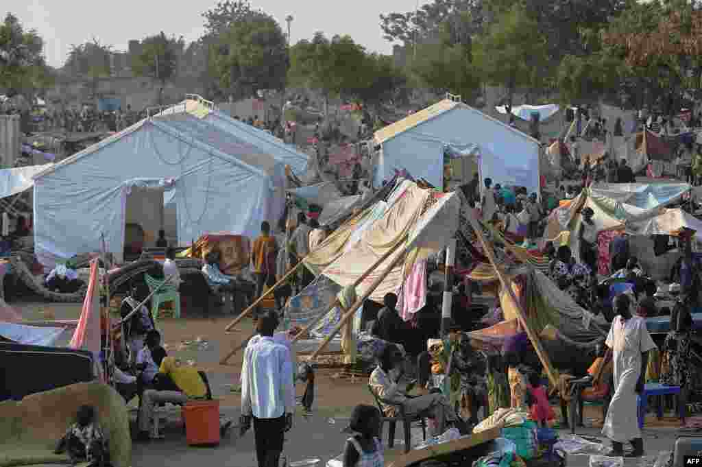 People gather at a makeshift camp at the United Nations Mission in South Sudan (UNMISS) compound in Juba, Dec. 22, 2013, a week after South Sudan erupted in violence.