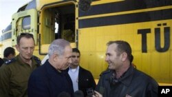 Israel's Prime Minister Benjamin Netanyahu shakes hands with the head of a Turkish delegation of fire fighters and firefighting planes that arrived at Ramat David air force base in northern Israel to help fight a wildfire, 03 Dec 2010