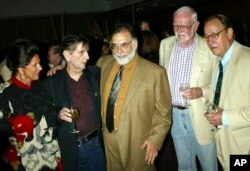 """FILE - In this July 18, 2003, file photo, from left, Lainie Kazan, Harry Dean Stanton, Francis Ford Coppola, Frank Pierson and Frederic Forrest reunite during a reception for the screening of the 1982 movie """"One from the Heart,"""" at the Academy of Motion Picture Arts and Sciences in Beverly Hills, Calif."""