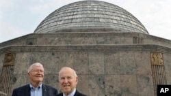 FILE - Apollo 13 crew members Commander Captain James A. Lovell, Jr., right, and Lunar Module Pilot Fred W. Haise pose for a photo during a 40th Anniversary reunion of the moon mission at the Adler Planetarium, April 12, 2010, in Chicago.