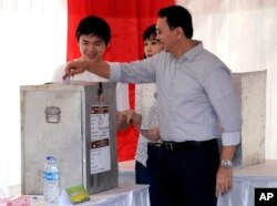 "Jakarta Governor Basuki ""Ahok"" Tjahaja Purnama who is seeking his second term in office, files his ballot at a polling station during the runoff election in Jakarta, Indonesia, April 19, 2017."