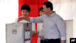 "Jakarta Governor Basuki ""Ahok"" Tjahaja Purnama, who is seeking his second term in office, files his ballot at a polling station during the runoff election in Jakarta, Indonesia, April 19, 2017."