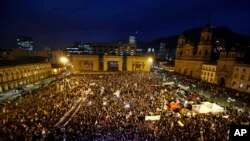 People gather at Bolivar's square during a peace march in Bogota, Colombia, Oct. 12, 2016. Thousands of rural farmers, indigenous activists and students marched in cities across Colombia to demand a peace deal between the government an leftist rebels not