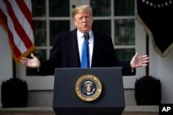 President Donald Trump speaks in the Rose Garden at the White House, Feb. 15, 2019.