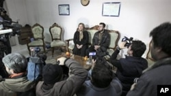 Iranian Sakineh Mohammadi Ashtiani, left, who has been sentenced to death by stoning for adultery, attends a news briefing as she meets with her son, Sajjad, in the northwestern city of Tabriz, Iran, 01 Jan 2011.