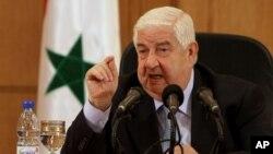 Bộ trưởng Ngoại giao Syria Walid al-Moallem phát biểu trong cuộc họp báo ở Damascus, ngày 27 tháng 8, 2013.