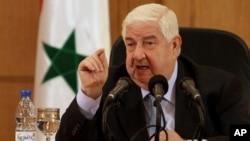 Սիրիայի արտգործնախարար Վալիդ ալ-Մոալեմ, Դամասկոս, 27 օգոստոսի 2013թ.