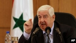 FILE - Syrian Foreign Minister Walid al-Moallem.