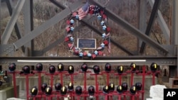 FILE - A memorial to 29 miners killed in an April 2010 explosion is shown Dec. 3, 2015, at the entrance to the Upper Big Branch mine in Montcoal, West Virginia. Don Blankenship, former CEO of Massey Energy, was convicted of conspiring to willfully violate