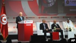 "Tunisian President Beji Caid Essebsi (L) delivers his speech during the opening ceremony of ""Tunisia 2020,"" an international investment conference, in Tunis, Tunisia, Nov. 29, 2016. International investors are converging on Tunisia as the country's government tries to drum up billions of dollars to keep its young democracy from falling into economic collapse."