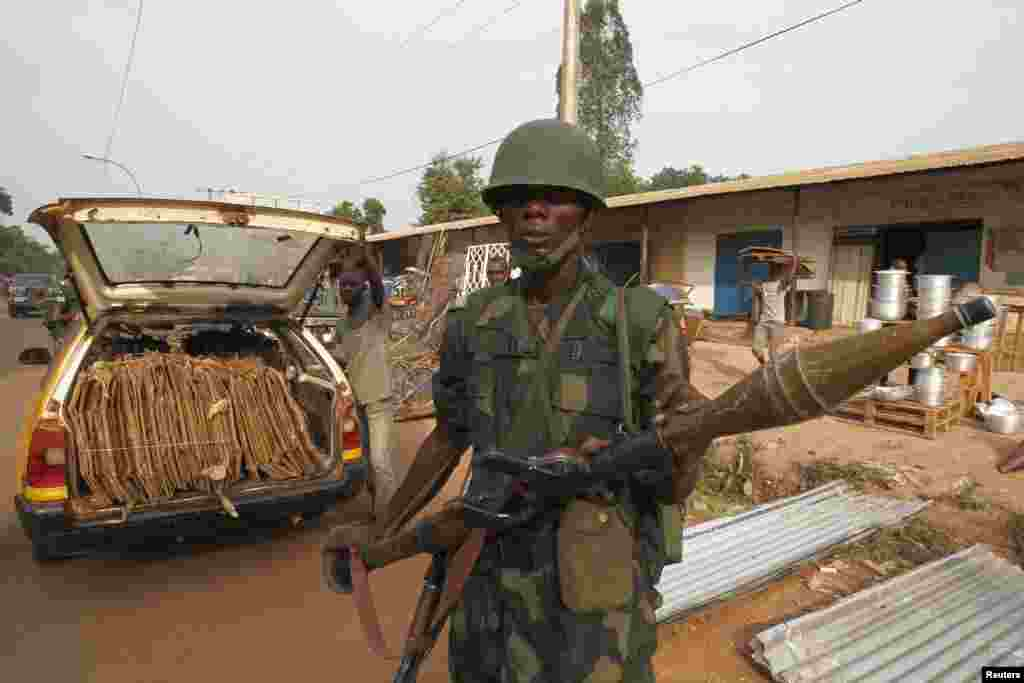 A DRC soldier, part of an African peacekeeping force, patrols along a street in Bangui, Feb. 12, 2014.