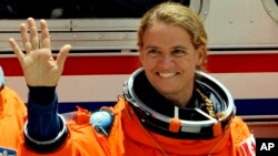 Mission Specialist Julie Payette, of Canada, prepares to board the space shuttle Endeavour, July 15, 2009, at the Kennedy Space Center in Cape Canaveral, Fla. Payette, now retired, is reported to be named the next governor general and Queen Elizabeth's representative in Canada.