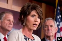 FILE - Rep. Kristi Noem, R-S.D., speaks to reporters on Capitol Hill, Washington, Aug. 1, 2013.
