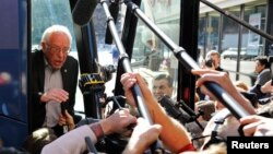 FILE - U.S. Democratic presidential candidate Bernie Sanders speaks to reporters from his bus outside his campaign's Iowa headquarters in Des Moines, Iowa, Feb. 1, 2016.