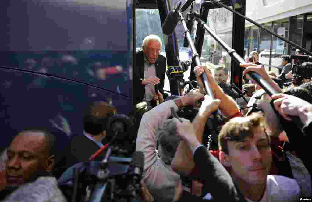 U.S. Democratic presidential candidate Bernie Sanders speaks to reporters from his bus outside his campaign's Iowa headquarters in Des Moines, Iowa, Feb. 1, 2016.