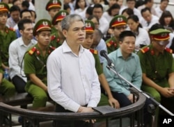 Nguyen Xuan Son, former general director of Ocean Bank, appears in a court in Hanoi, Vietnam, Monday, Aug. 28, 2017. Son and 50 bankers and business executives were put on trial Monday for alleged graft and mismanagement causing $69 million in losses to the bank.