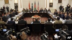 FILE - Delegations from Afghanistan, Pakistan, China and the United States discuss a roadmap for ending the war with the Taliban, at the Presidential Palace in Kabul, Afghanistan, Jan. 18, 2016.
