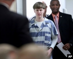 FILE - Dylann Roof enters the court room at the Charleston County Judicial Center to enter his guilty plea on murder charges in Charleston, S.C., April 10, 2017.