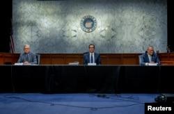 U.S. Senate Majority Leader Mitch McConnell, and U.S. Senate Minority Leader Chuck Schumer meet with Treasury Secretary Steve Mnuchin (C) to work on coronavirus economic aid legislation, on Capitol Hill, in Washington, March 20, 2020.