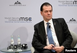 FILE - Romania's Prime Minister Ludovic Orban listens during a panel discussion at the annual Munich Security Conference in Germany, Feb. 16, 2020.