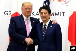 President Donald Trump meets with Japanese Prime Minister Shinzo Abe during a meeting on the sidelines of the G-20 summit in Osaka, Japan, June 28, 2019.