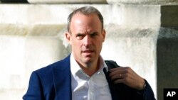 FILE - Britain's Foreign Secretary Dominic Raab arrives to attend a cabinet meeting at the Foreign and Commonwealth Office in London, Sept. 1, 2020.