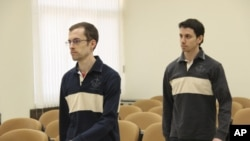 American hikers Shane Bauer (L) and Josh Fattal attend the first session of their trial at the revolutionary court in Tehran, Iran February 6, 2011.