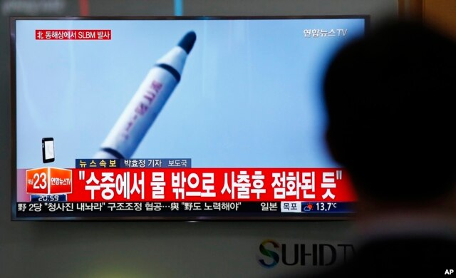 A man watches a TV news program showing a file footage of a missile launch conducted by North Korea, at the Seoul Train Station in Seoul, South Korea, April 23, 2016.