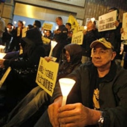 Protesters hold a candlelight vigil outside the China Liaison Office in Hong Kong in support of the Wukan villagers in December.