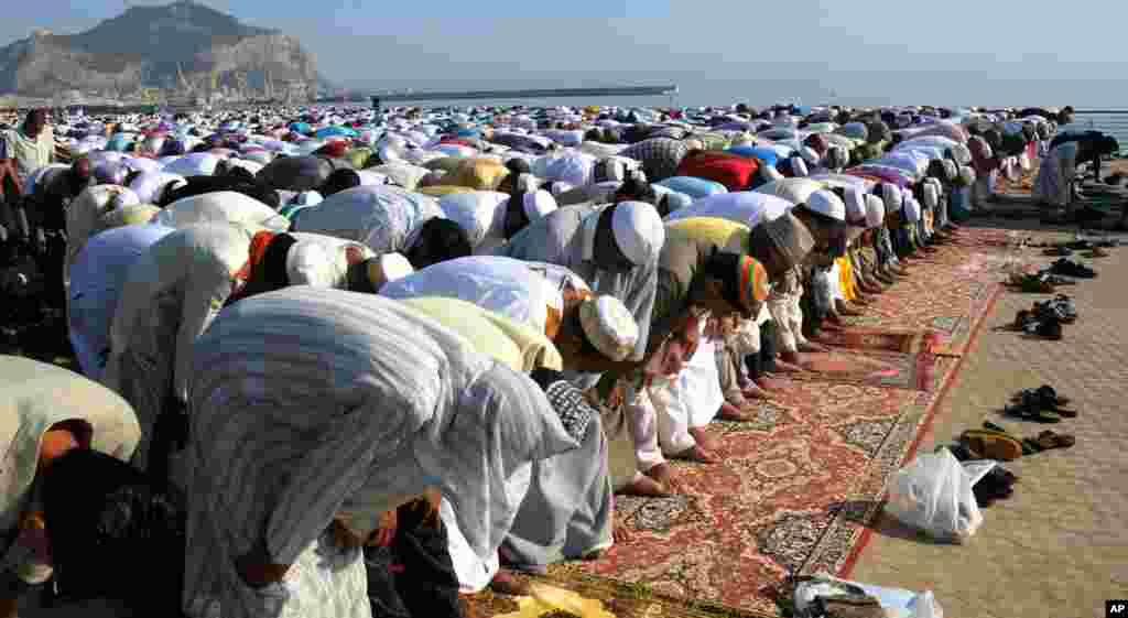 Muslims pray during Eid al-Fitr prayer, which marks the end of the holy month of Ramadan, in Palermo, Italy, August, 19, 2012.