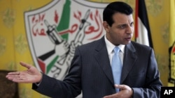 FILE - Palestinian Fatah leader Mohammed Dahlan gestures as he speaks during an interview with The Associated Press in his office in the West Bank city of Ramallah, Jan. 3, 2011.