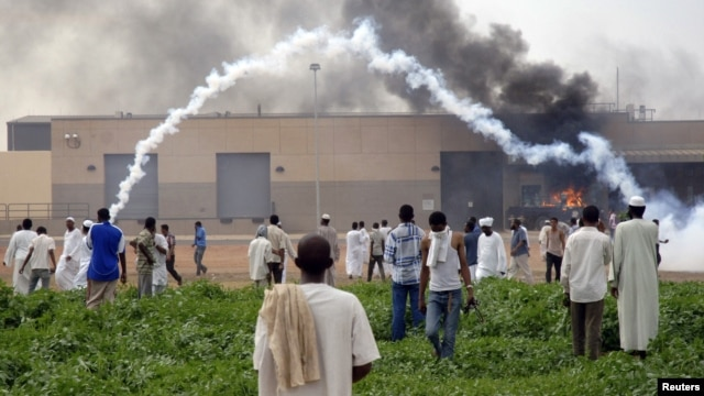 Sudanese demonstrators attack the U.S. embassy as they protest an anti-Islam film, in Khartoum, September 14, 2012.