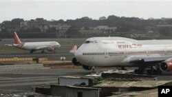 Air India planes are seen at the international airport in Mumbai, India, Tuesday, May 25, 2010. Air India employees staged a surprise strike Tuesday to protest a delayed salary payment, forcing cancellation of at least six flights, officials said. The wal