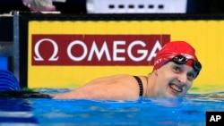 Katie Ledecky smiles after winning the women's 200-meter freestyle final at the U.S. Olympic swimming trials in Omaha, Neb., Wednesday, June 29, 2016.
