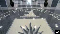 FILE - The CIA seal at CIA headquarters.