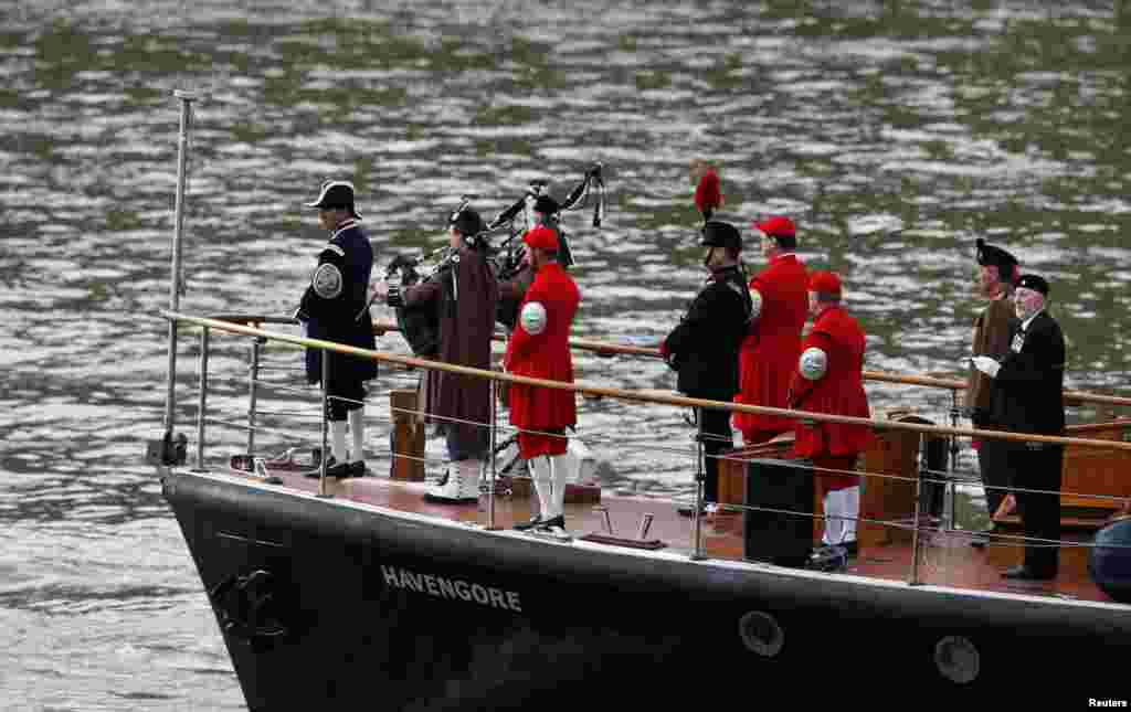 The 'Havengore', which carried Winston Churchill's coffin along the Thames, makes the same journey with members of his family onboard to mark the 50th anniversary of his funeral in London.