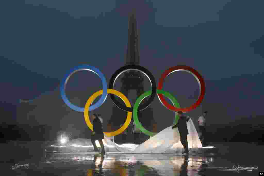Paris officials unveil a display of the Olympic rings on Trocadero plaza that overlooks the Eiffel Tower, after the vote in Lima, Peru, awarding the 2024 Games to the French capital, in Paris, France.