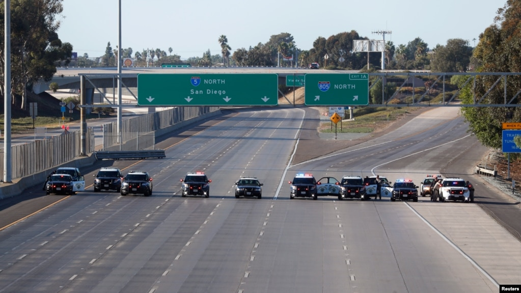 FILE - California Highway Patrol police cars block the highway leading from Mexico into San Diego after the border between Mexico and the U.S. was temporarily closed in the San Ysidro neighborhood of San Diego, California, Nov. 25, 2018.