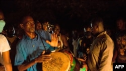 FILE - Supporters of Malian politician Soumaila Cisse celebrate in front of his house in Bamako, Mali, on Oct. 8, 2020, after hearing the news that he landed at the Bamako airport after having been freed from captivity.